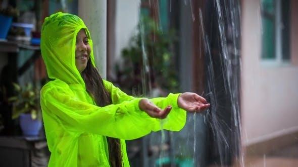 Thumbnail for Happy Girl Enjoying Rainy Weather