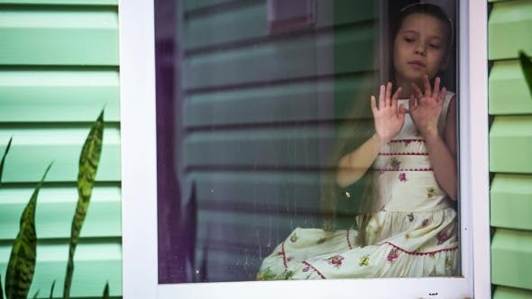 Thumbnail for Sad Girl Sitting At Window And Looking At Rain
