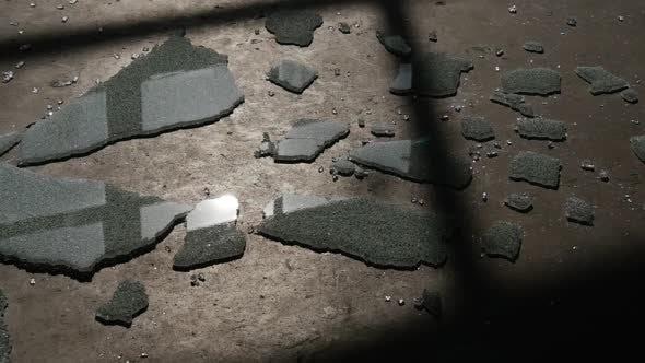 Thumbnail for Glass Sheet is Lying on the Floor, Dark Room,