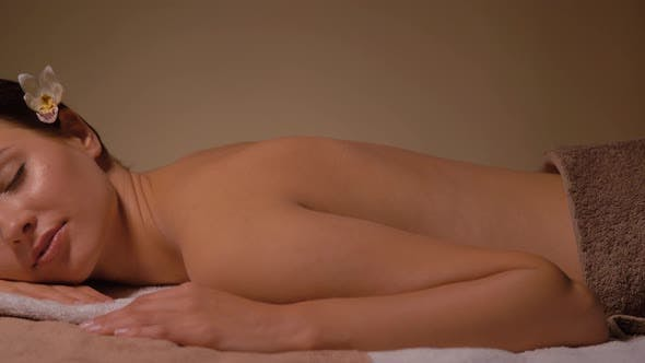 Thumbnail for Young Woman Lying at Spa or Massage Parlor