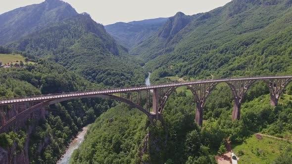 Thumbnail for Aerial View on Djurdjevica Arch Bridge Over Tara