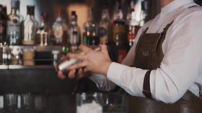 The Bartender Makes a Cocktail