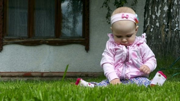 Thumbnail for Seven Month Baby Plays On a Lawn