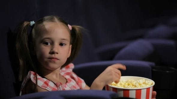 Thumbnail for Beautiful Little Girl Waching Movie In The Cinema