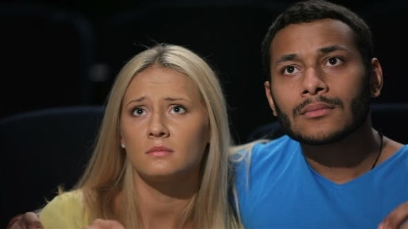 Cover Image for Young Couple Watching Movie