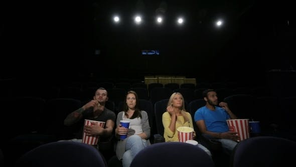 Thumbnail for Group Of Friends Wathing Film In Cinema