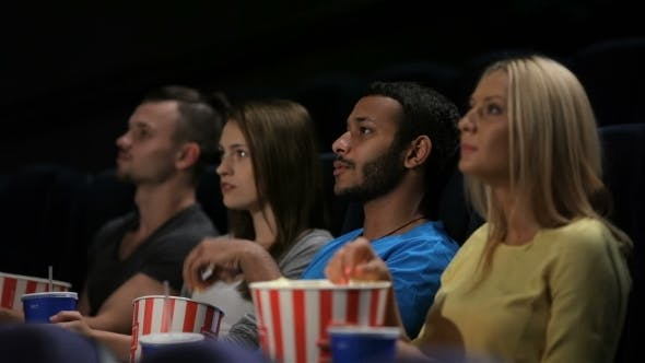 Thumbnail for Group Of Friends Watching Film In Cinema