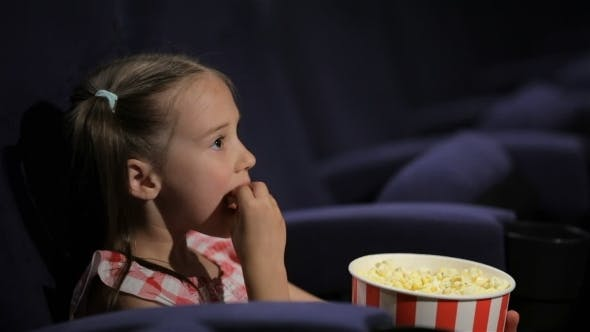 Cover Image for Beautiful Little Girl Waching Movie In The Cinema