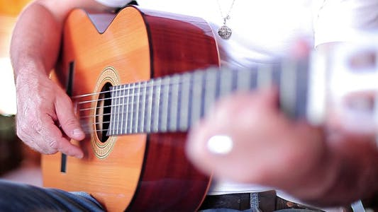 Thumbnail for Playing A Guitar