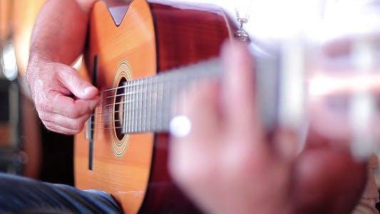 Playing Guitar At Studio