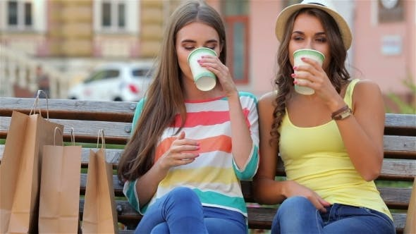 Cover Image for Two Girls On a Bench Drinking Coffee