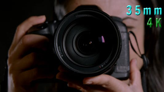 Thumbnail for Photographer Operating A Camera 11