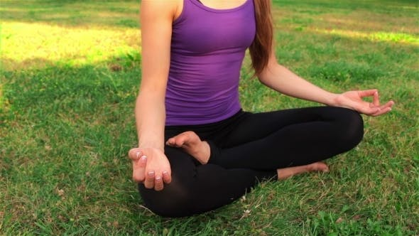 Thumbnail for Young Girl Doing Yoga In The Park