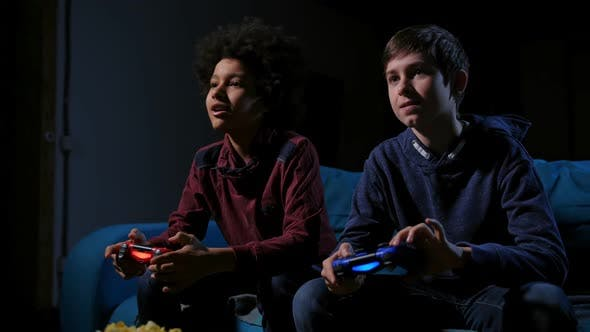 Thumbnail for Smiling Teenagers Playing Video Games at Home