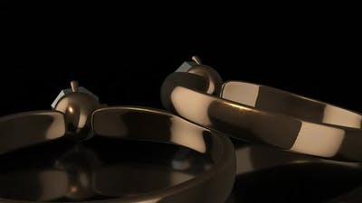 3D Golden Rings in Black Background