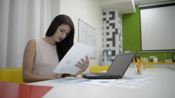 Thumbnail for Girl Going Through Financial Report