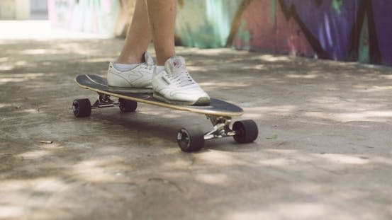 Thumbnail for Feet Of a Man In Sneakers On Top Of Longboard