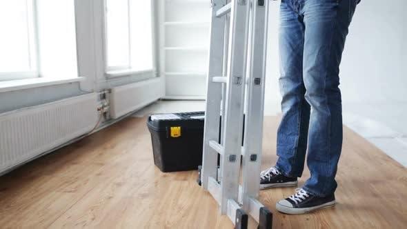 Thumbnail for Close Up Of Man Bringing Tool Box And Ladder 1