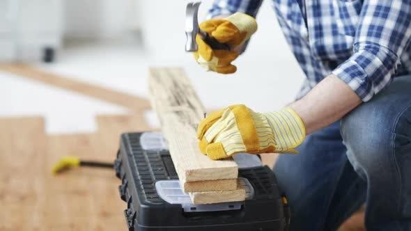 Thumbnail for Close Up Of Man Hammering Nail To Wooden Board 1