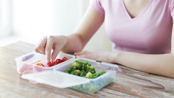 Thumbnail for Close Up Of Woman Eating Vegetables From Container 3
