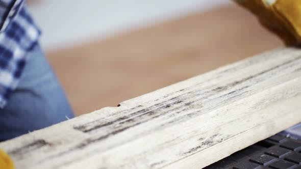 Thumbnail for Close Up Of Man Hammering Nail To Wooden Board 12