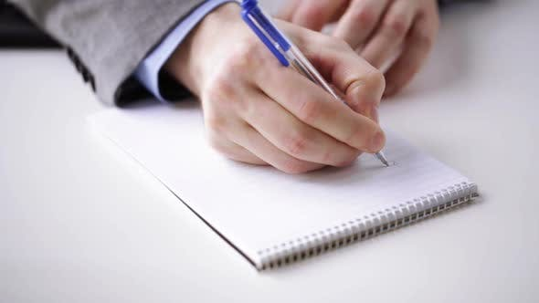 Thumbnail for Close Up Of Businessman Hand Writing To Notepad 1