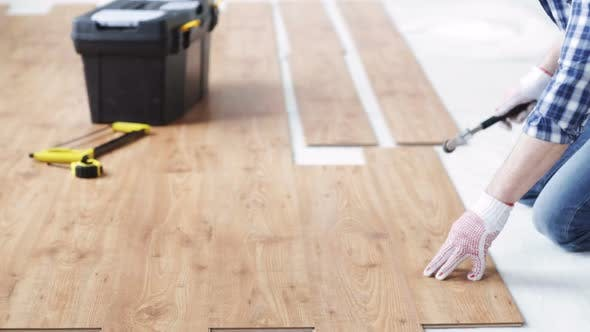 Thumbnail for Close Up Of Man Installing Wood Flooring 1