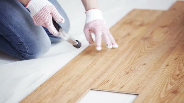 Thumbnail for Close Up Of Man Installing Wood Flooring 12