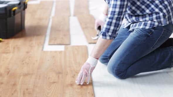 Thumbnail for Close Up Of Man Installing Wood Flooring 2