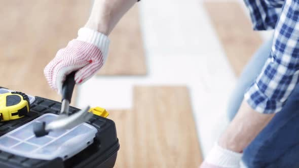Thumbnail for Close Up Of Man Installing Wood Flooring 4