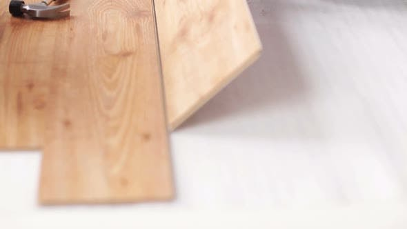 Thumbnail for Close Up Of Man Installing Wood Flooring 5