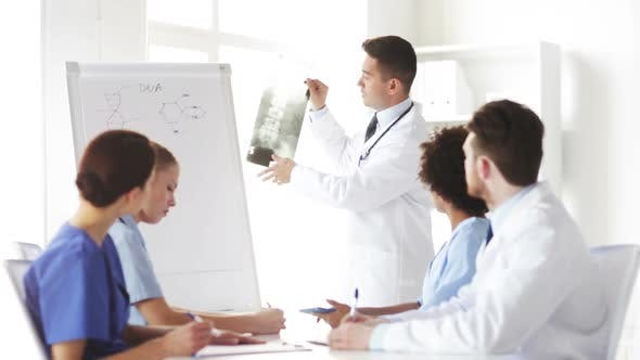 Thumbnail for Group Of Doctors Looking At X-Ray In Hospital