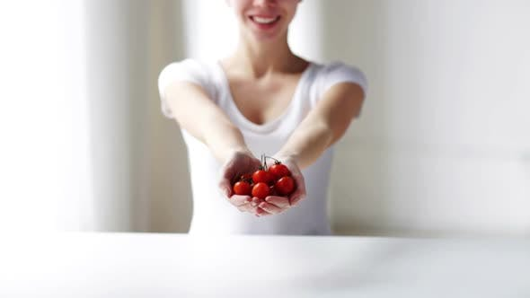 Thumbnail for Close Up Of Young Woman Showing Cherry Tomatoes 1