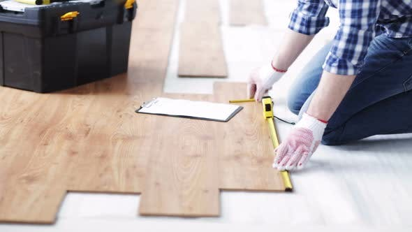 Thumbnail for Close Up Of Man Measuring Flooring And Writing 1