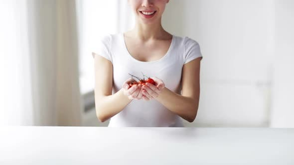 Thumbnail for Close Up Of Young Woman Showing Cherry Tomatoes 4