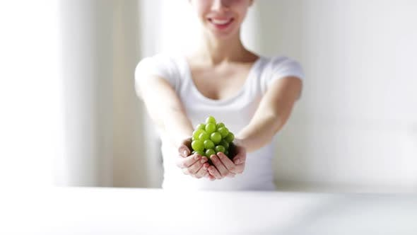 Thumbnail for Close Up Of Young Woman Showing Green Grape Bunch 1