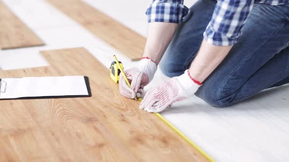 Thumbnail for Close Up Of Man Measuring Flooring And Writing 4