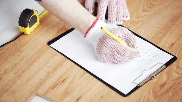 Thumbnail for Close Up Of Man Measuring Flooring And Writing 6
