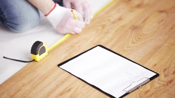 Thumbnail for Close Up Of Man Measuring Flooring And Writing 7
