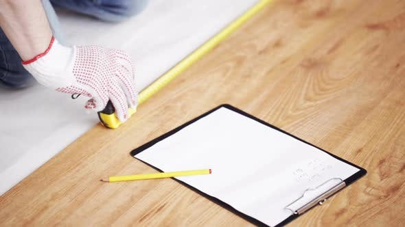 Thumbnail for Close Up Of Man Measuring Flooring And Writing 8