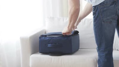 Close Up Of Man Packing Clothes Into Travel Bag 1