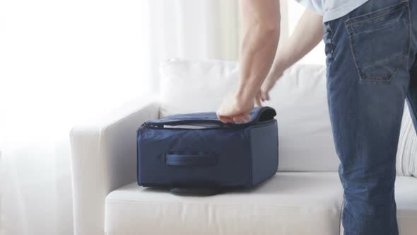 Thumbnail for Close Up Of Man Packing Clothes Into Travel Bag 1
