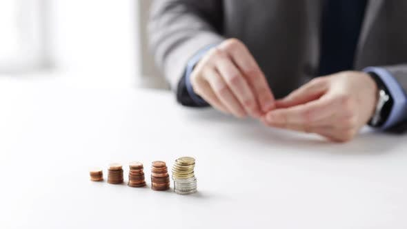 Thumbnail for Close Up Of Businessman Putting Coins Into Columns 1