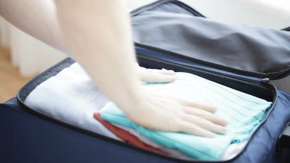 Thumbnail for Close Up Of Man Packing Clothes Into Travel Bag 4