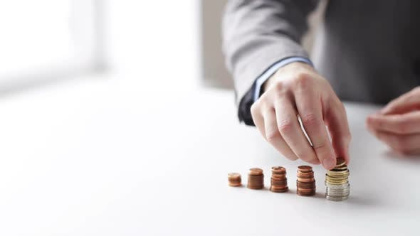 Thumbnail for Close Up Of Businessman Putting Coins Into Columns 3
