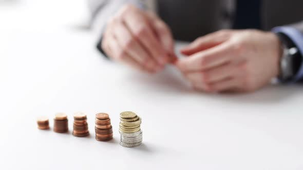 Thumbnail for Close Up Of Businessman Putting Coins Into Columns 4
