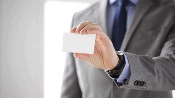 Thumbnail for Close Up Of Businessman Showing White Blank Card 3