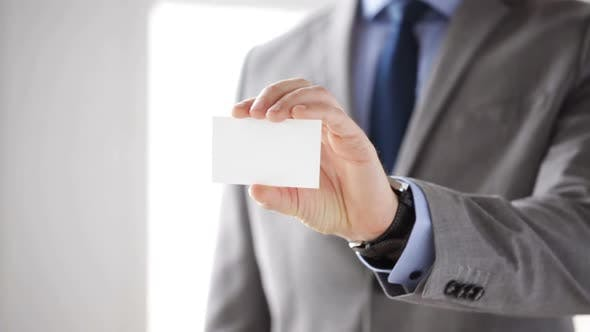 Cover Image for Close Up Of Businessman Showing White Blank Card 4