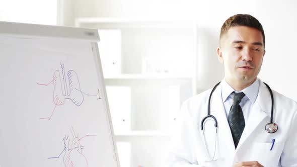 Thumbnail for Happy Doctor Showing Medical Drawing On Flip Board 2