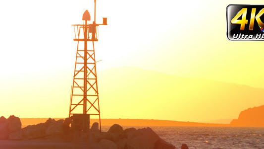 Thumbnail for Lighthouse and the People Silhouette in Sunset